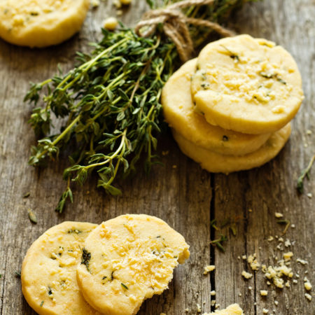 Shortbread cookies with thyme and parmesan on a wooden table